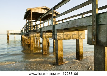 The popular old fishing pier at Lighthouse Beach on Sanibel Island, Florida, looking out over the Gulf Of Mexico. - stock photo