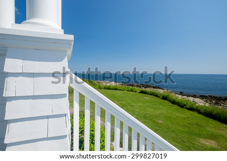 The porch and wooden railing with a view of the St George harbor at the Marshalls Point Lighthouse light keepers quarters - stock photo