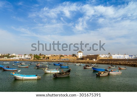 The port and the ancient medina of Asilah, North of Morocco - stock photo