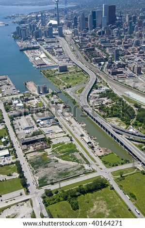 The Port Lands area of Toronto, Canada, seen from just above the junction of Commissioners and Saulter Streets, looking west towards the downtown core. - stock photo