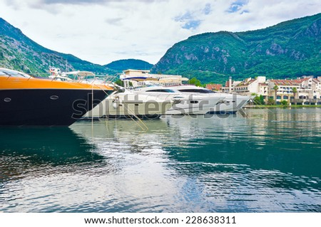 The port of Kotor with the numerous luxury yachts and cruise ships, Montenegro. - stock photo