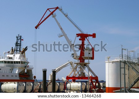 The Port of the oil project .The Tap, tanks, ship beside quay. - stock photo