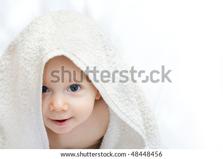 the portait of little baby boy with the towel on white - stock photo