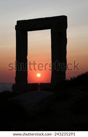 The Portara Gate of the Apollo Temple in Naxos island - stock photo