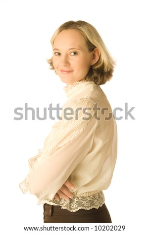 The portrait of a smiling woman looking back over her shoulder - stock photo