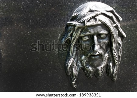the portrait of jesus christ on the cross from a tomb - stock photo
