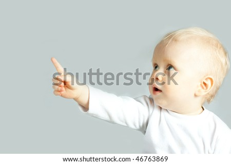 the portrait of little boy showing the finger on white - stock photo