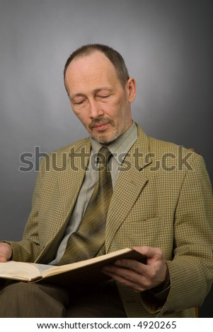 the portrait of senior man with book - stock photo