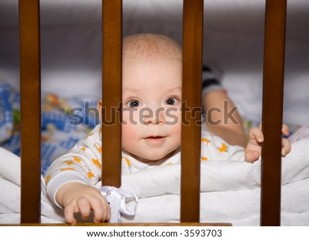 the portrait of small boy lying in bed - stock photo