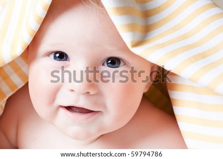 The portrait of smiling baby - stock photo