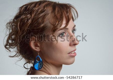The portrait of the beautiful young attractive woman