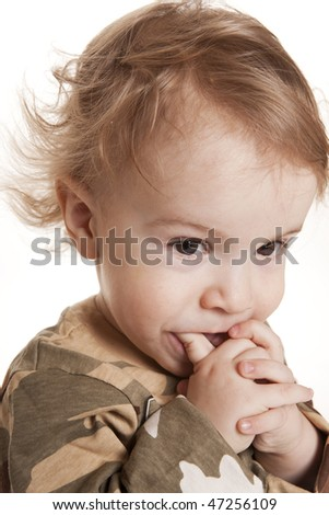 The portrait of the nice boy has put on in a camouflage - stock photo