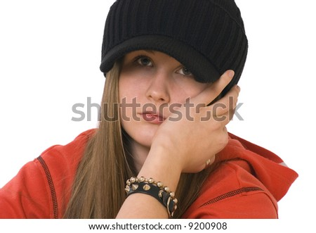 The portrait of the teenage girl dressed with the black cap on the white background.