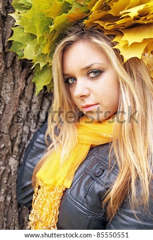 the portrait of young blonde in the autumn garland