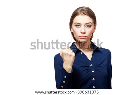 The portrait the young beautiful woman threatens with a fist is isolated on white - stock photo