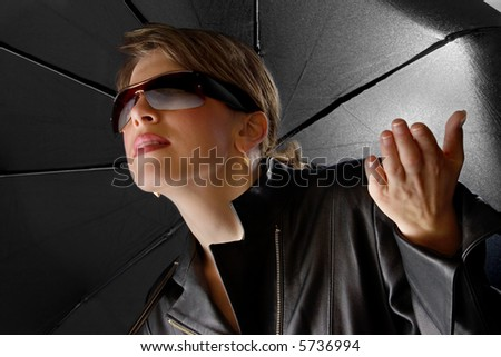 The posing woman with a umbrella - stock photo