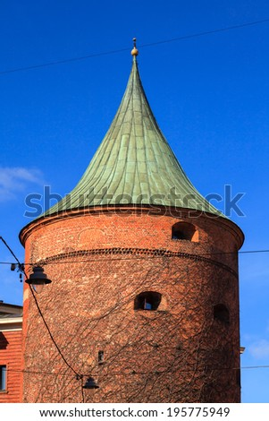 The Powder Tower.  The Powder Tower in Riga, capital of Latvia, dates back to the 14th century and was originally part of the defensive fortress surrounding the old town. - stock photo