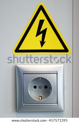 The power socket and electrical sign electrical hazards. - stock photo
