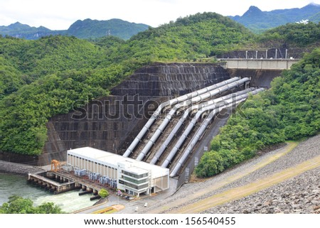 The power station 720 MW capacity of Srinagarind Dam  on the Khwae Yai river in Kanchanaburi Province,  It is a 140 m tall and 610 m long embankment dam. It with holds  reservoir of 7,470,000,000 m3   - stock photo