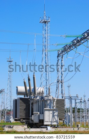 The powerful transformer on electrical substation - stock photo