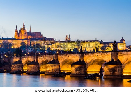 The Prague Castle (built in gothic style) and Charles Bridge are the symbols of Czech capital, built in medieval times. Twilight view of Prague - stock photo