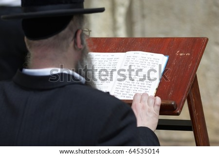 The prayer near Western Wall in Jerusalem - stock photo