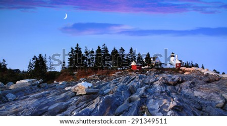 The Pre Dawn Night Is Turned To Daylight In This Time Exposure Of The Rugged Sea Coast At The Foot Of The Pemaquid Point Lighthouse, Bristol Maine, USA - stock photo