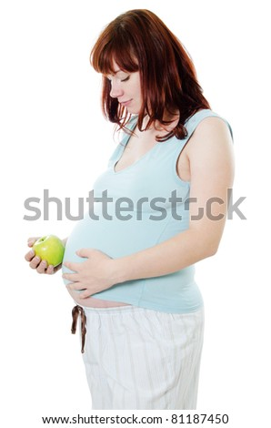 The pregnant woman with an apple isolated
