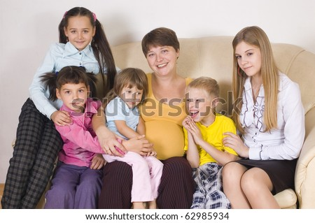The pregnant woman with five children of different age - stock photo