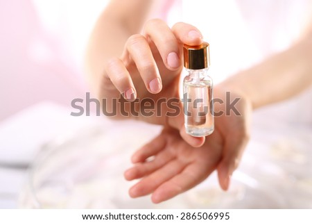 The preparation for nail care.The bottle with the preparation for the care of cuticles and nails - stock photo