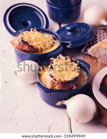 The preparation of a traditional French onion soup. Selective focus. - stock photo