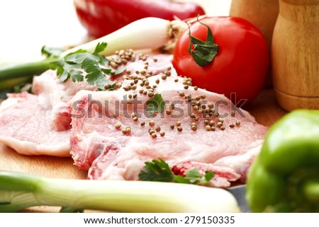the preparation of meat and vegetables for a meal - stock photo