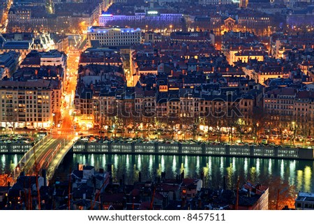 The presqu'ile of lyon at night between the Rhone and the Soane - stock photo