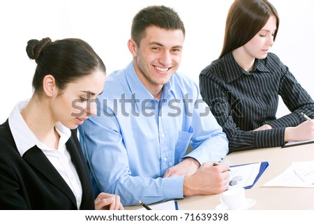 The pretty businessman smiles looking at camera - stock photo
