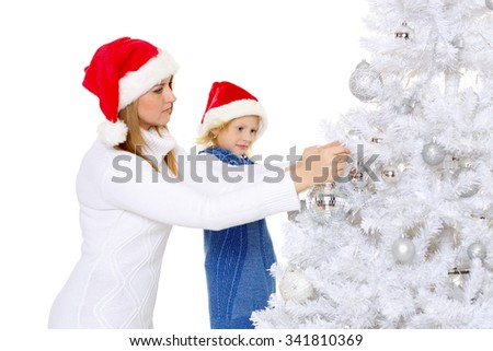 The pretty girl with mum decorate a Christmas tree on a white background. Happy family.