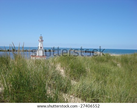 The pretty little lighthouse and harbor at New Buffalo, on Lake Michigan in the Midwest - stock photo
