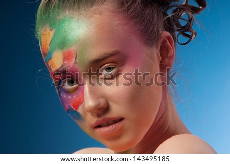 the pretty woman with the fantastic cosmetic picture on her face