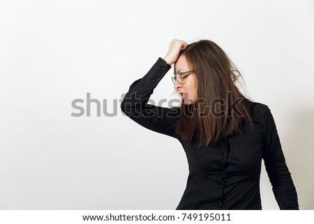 The pretty worried and pensive brown-haired woman in glasses for sight and headache, dressed in dark black shirt lost in thought and conjectures, on a white background. Emotions concept.