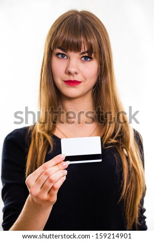 The pretty, young girl  holds out business card. Isolated on white. - stock photo