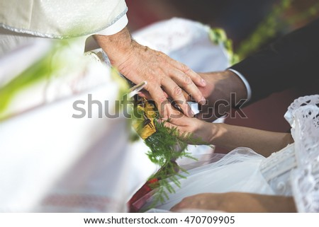 The priest marries the couple