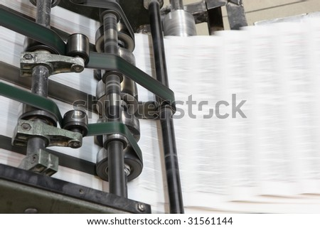The printed machine does the newspaper - stock photo