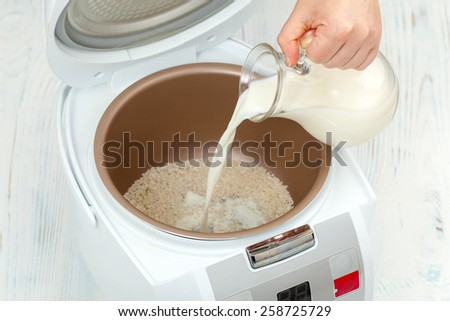 The process of cooking rice porridge in multicooker closeup - stock photo
