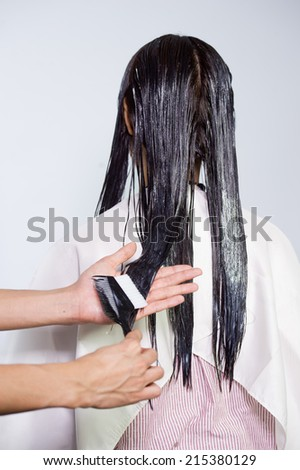 The process of hair coloring,hair coloring,Hair Colouring in process,Woman gets new hair colour,Hair Colouring in process - stock photo