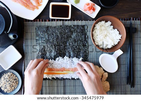 The process of making sushi and rolls, top view - stock photo