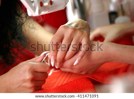 The process of nail cutting during nail care cosmetic treatment - stock photo