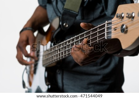 The process of playing the electric guitar. Male hands on the professional musical instrument for playing rock. Isolated.