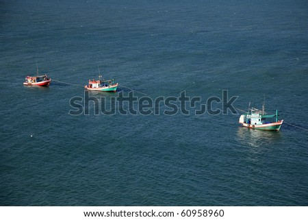 The procession of fishing boats in the Thai gulf. - stock photo