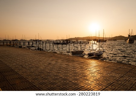The promenade at sunset in the resort of Bodrum in Turkey. - stock photo