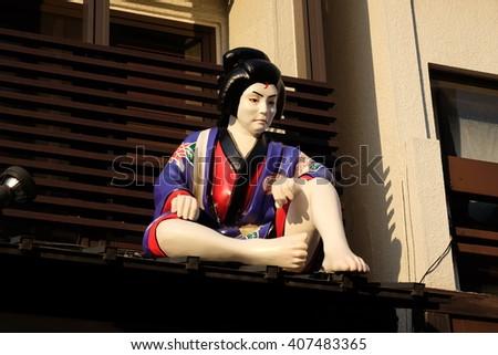 The public statue of samurai on the roof in Asakusa area, Tokyo, Japan.  - stock photo