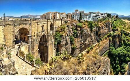 The Puente Nuevo bridge divides the city of Ronda, in southern Spain.  - stock photo
